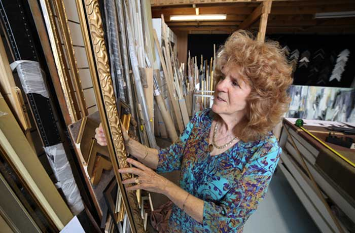 Cynthia inspects business framing moldings at the Campbelltown Framing Gallery