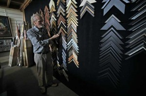 Ed inspects moulding samples at Campbelltown Framing Gallery